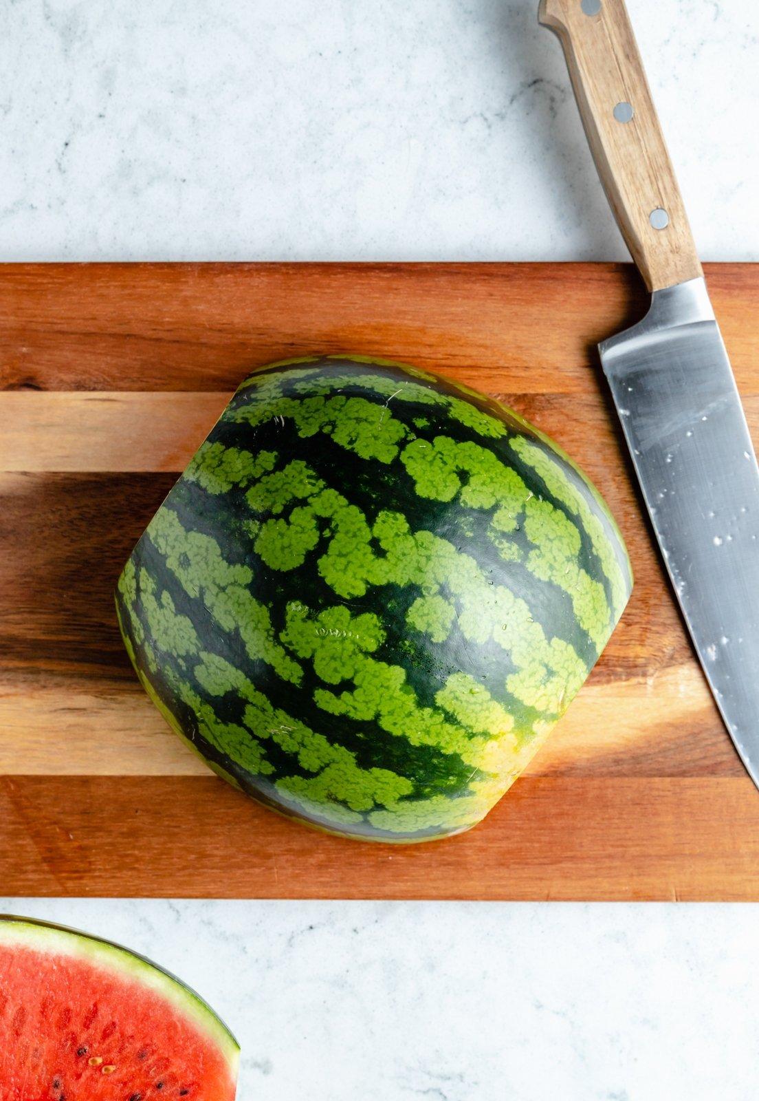 watermelon half on a cutting board