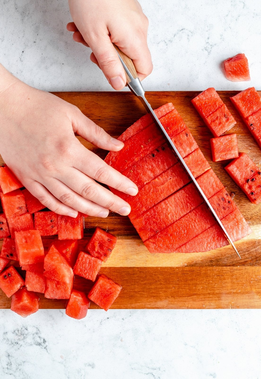 cutting a watermelon into cubes