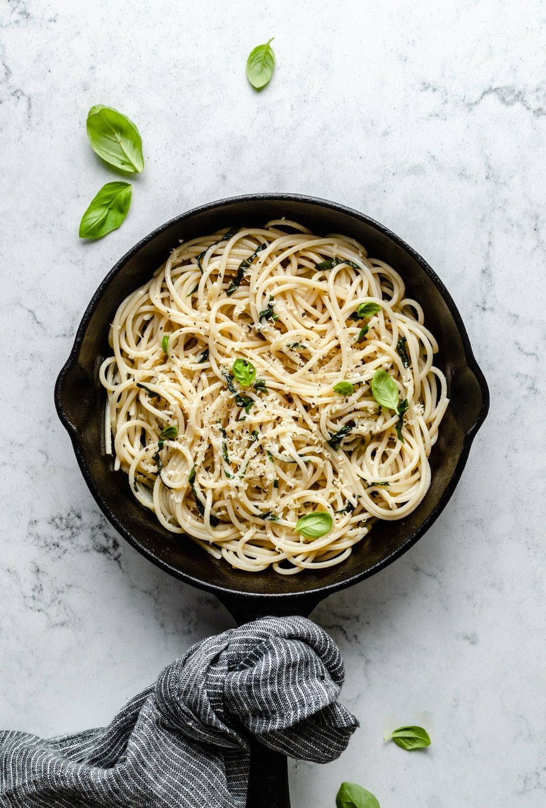pasta in a skillet cooked with frozen herbs