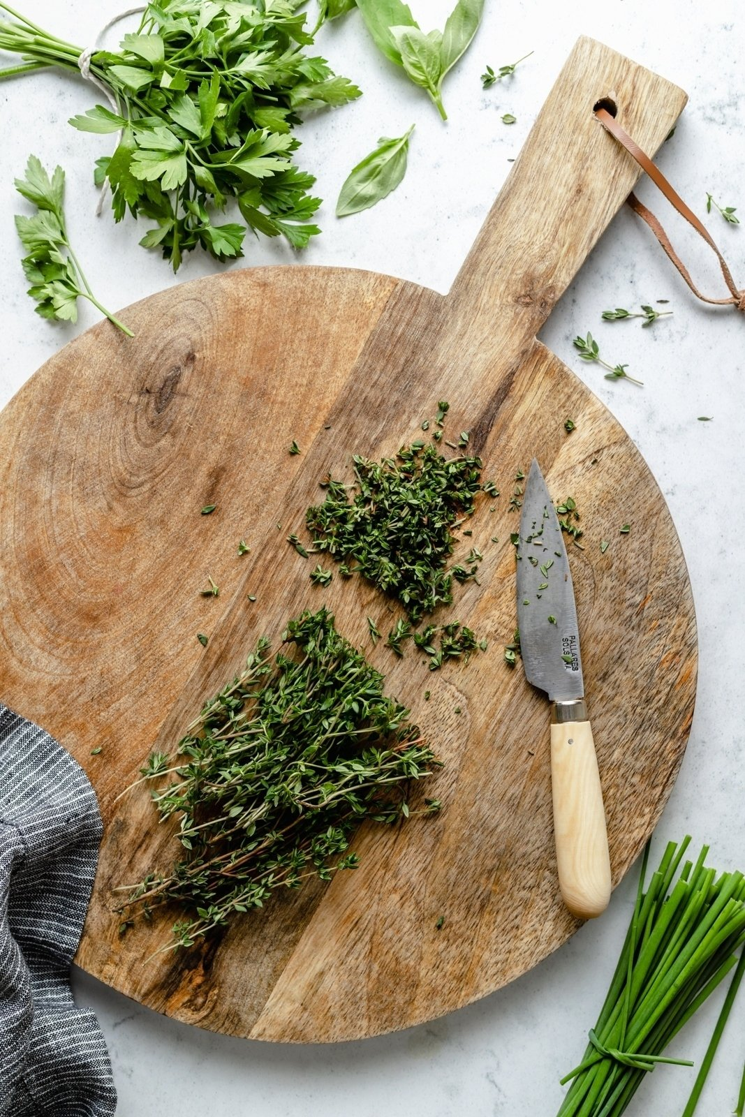 chopping herbs on a wooden board