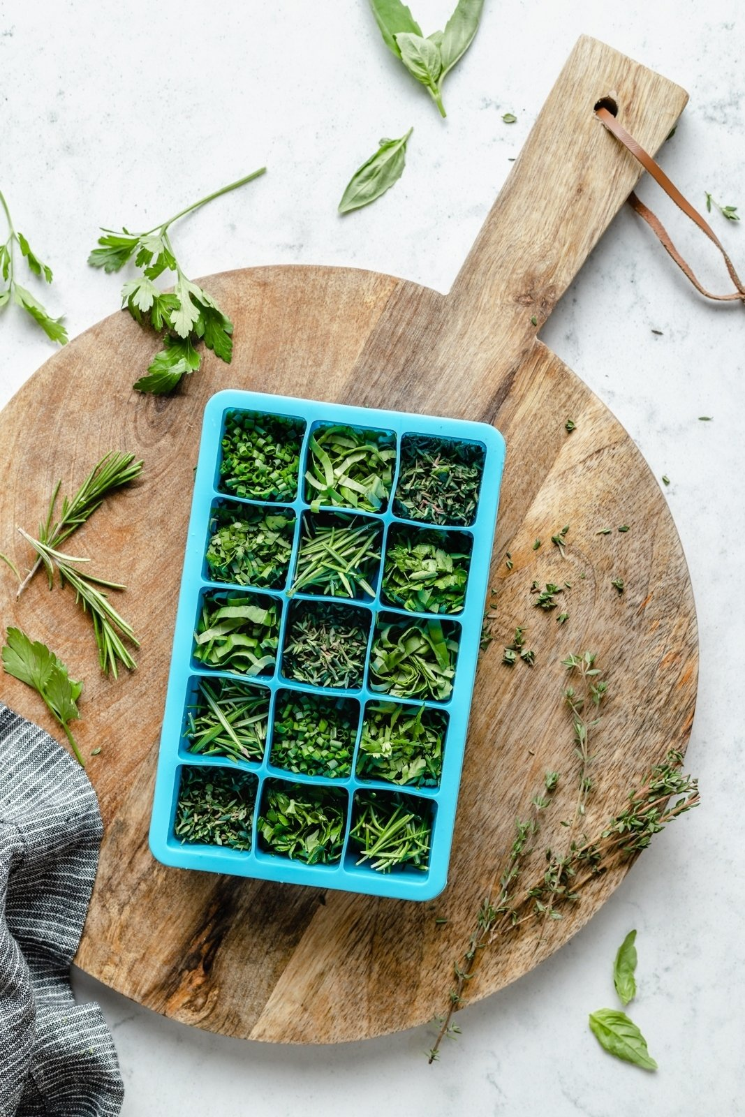 fresh herbs in a silicone ice tray