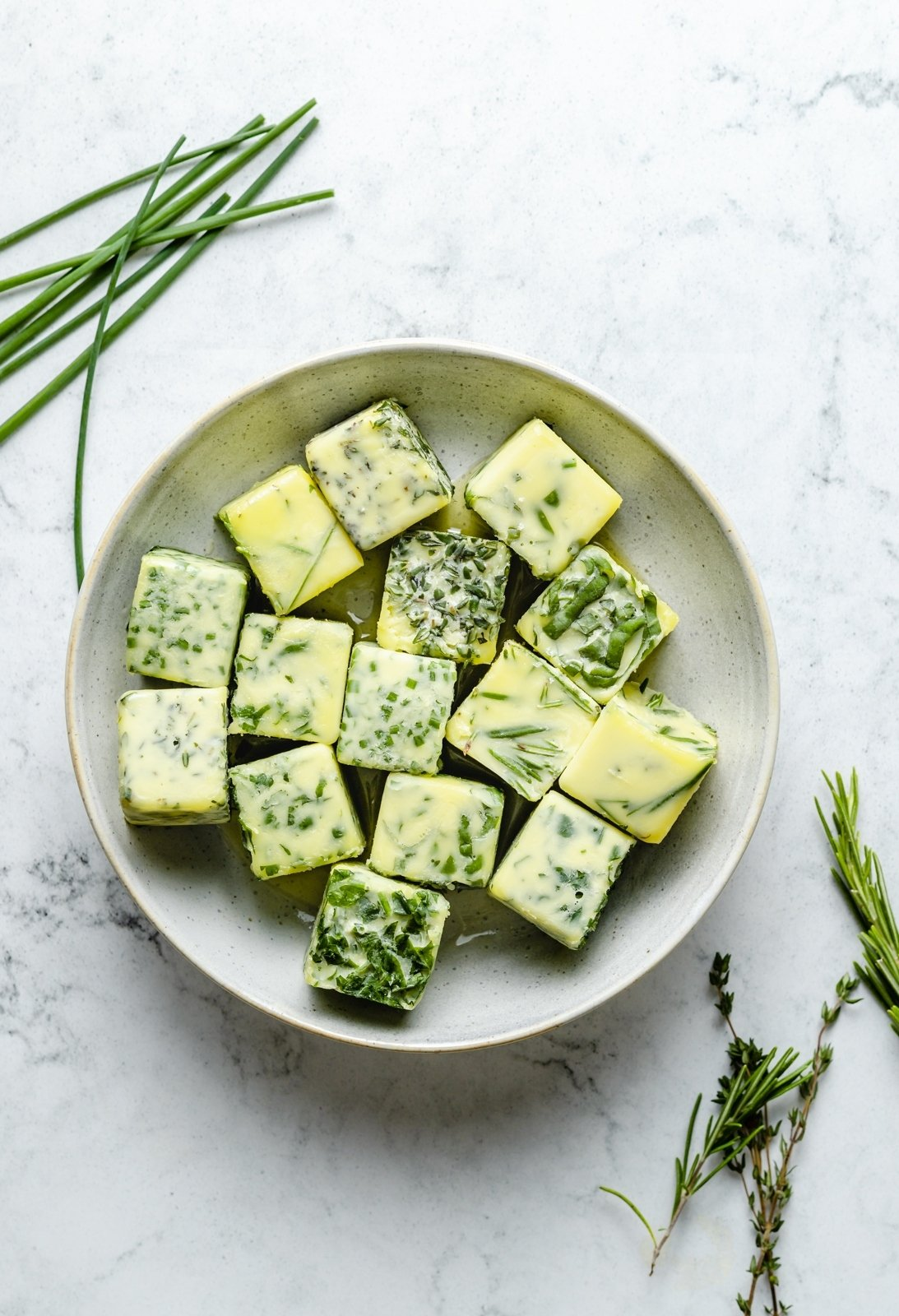 frozen herb cubes in a bowl