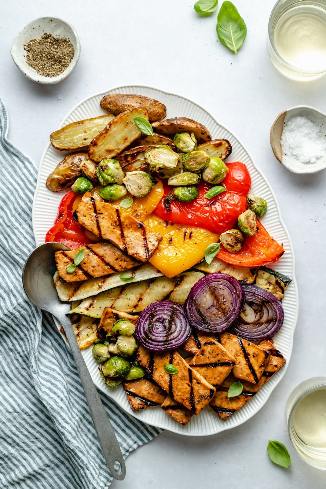 grilled tofu on a platter with grilled vegetables