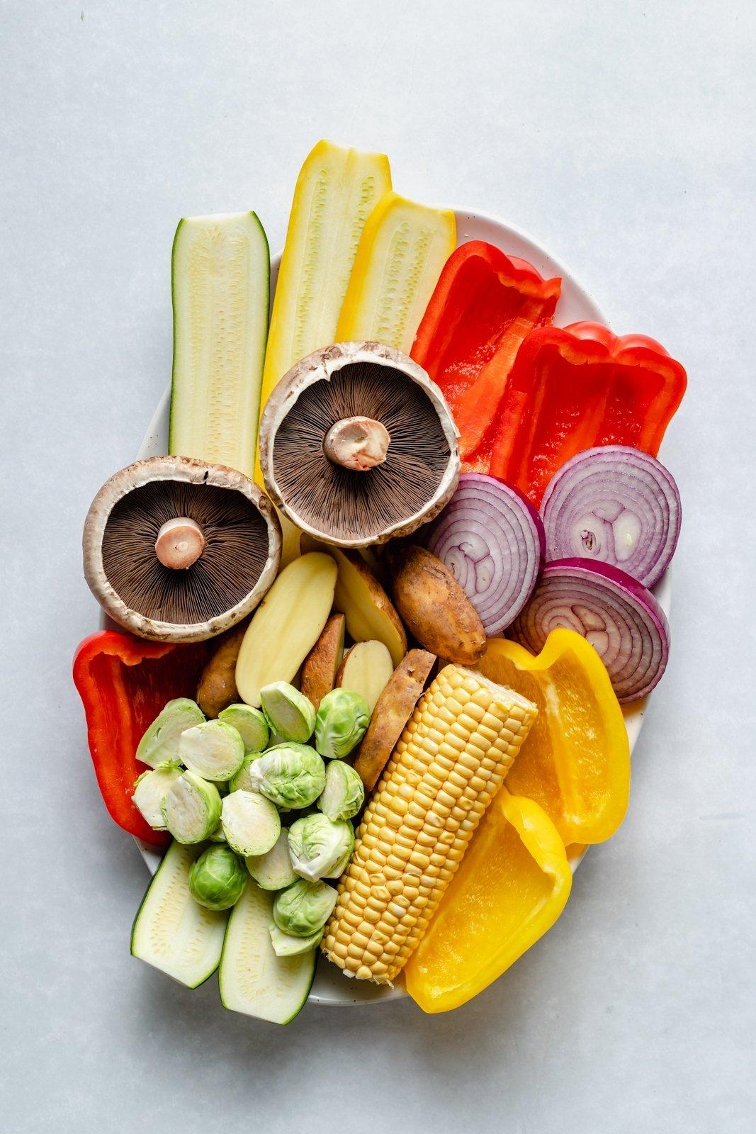 sliced vegetables on a platter for grilling