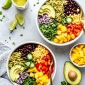 vegan green rice burrito bowls next to an avocado