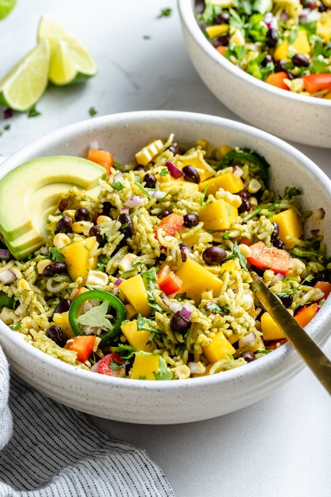 healthy green rice burrito bowl with avocado and mango