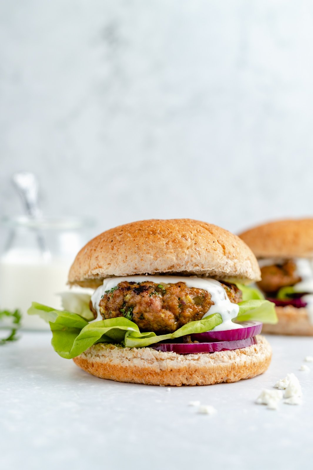 moroccan-inspired turkey burger topped with feta sauce