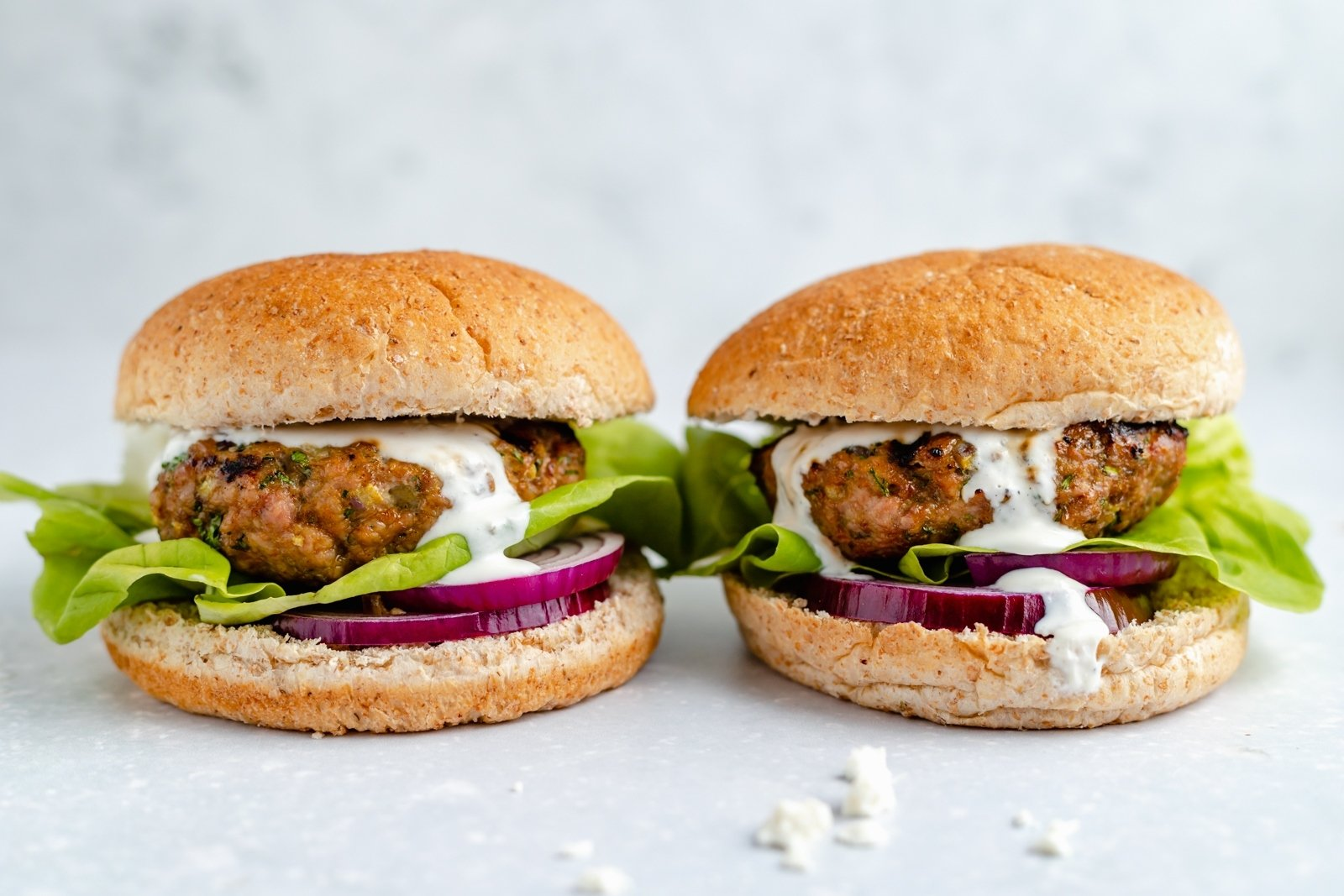two moroccan spiced turkey burgers next to each other