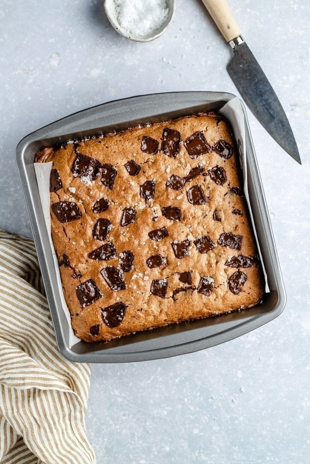 peanut butter cookie bars uncut in a baking pan