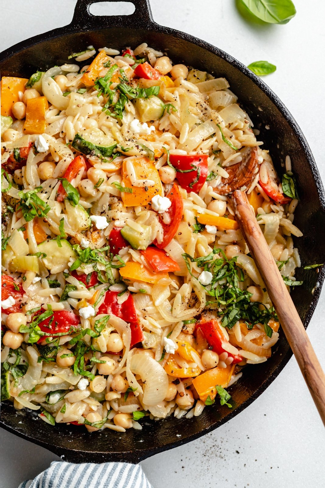 grilled vegetable orzo in a skillet