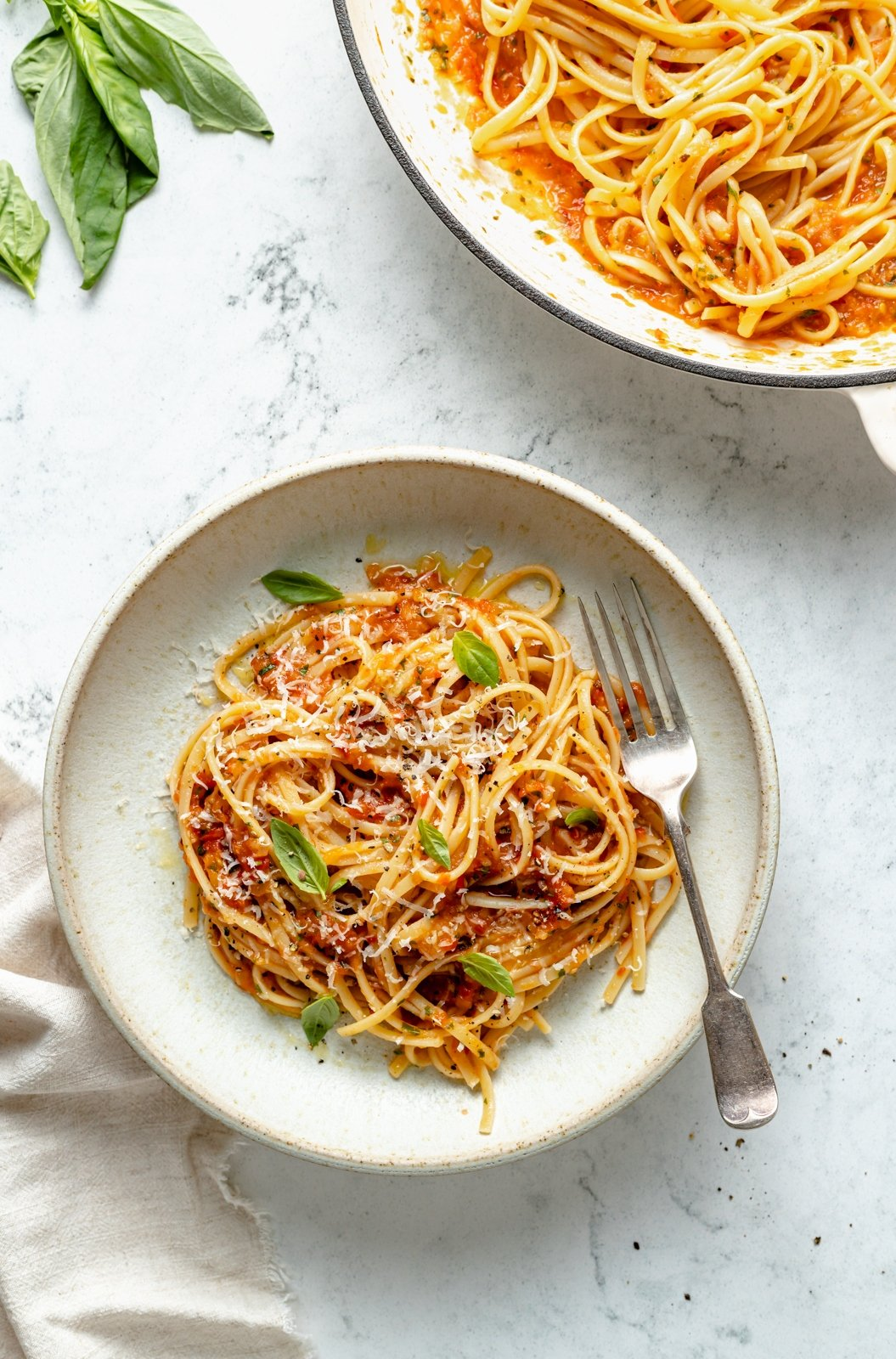 spaghetti with tomato sauce on a plate with a fork