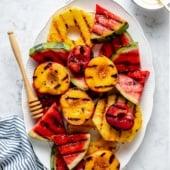 grilled fruit on a platter