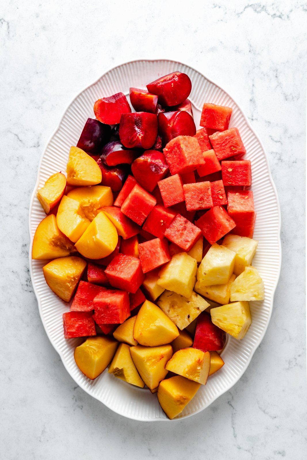 fruit cut into cubes on a tray