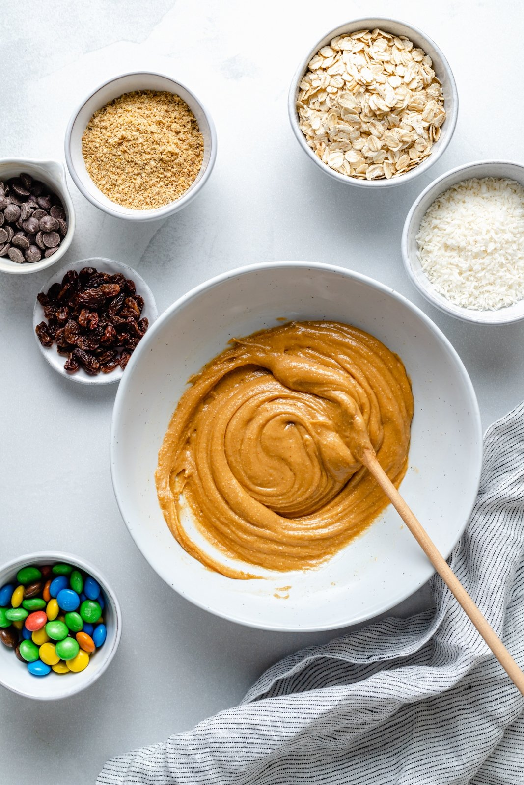 ingredients to make no bake monster cookie energy bites in bowls