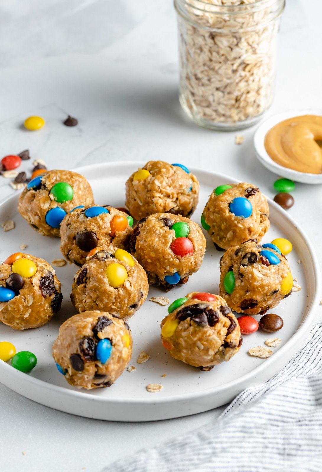 healthy monster cookie energy bites on a plate