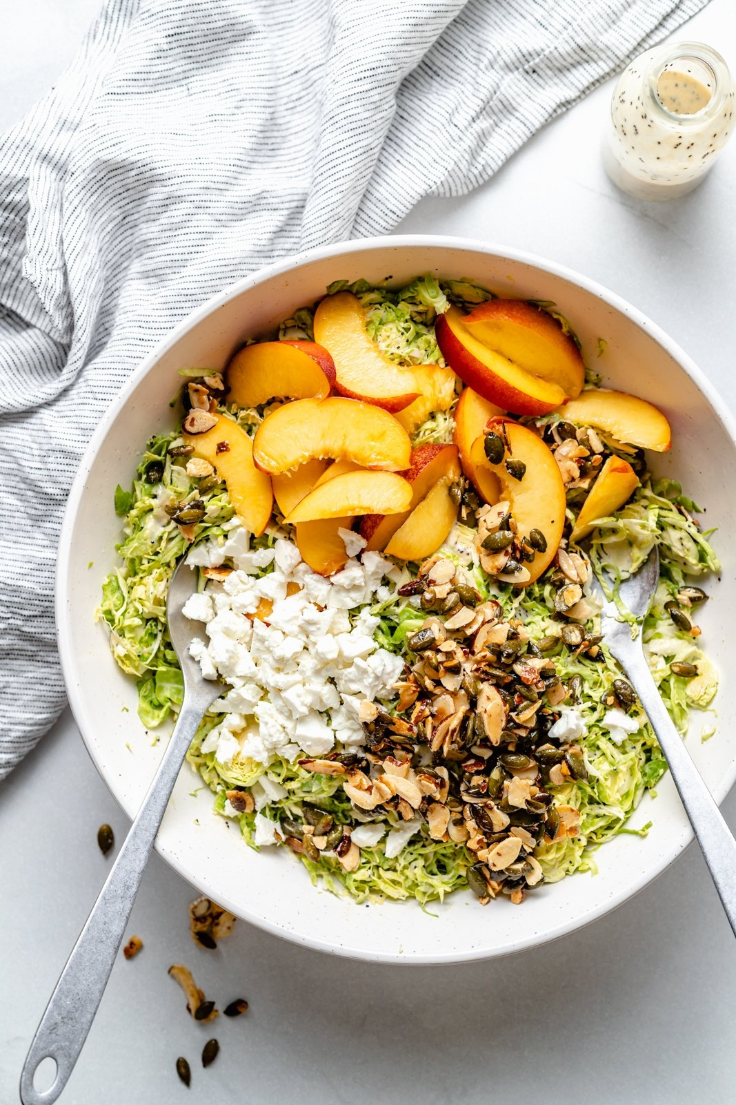 peach brussels sprouts salad in a bowl