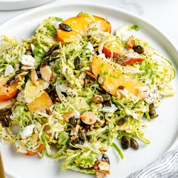 peach brussels sprouts salad on a plate