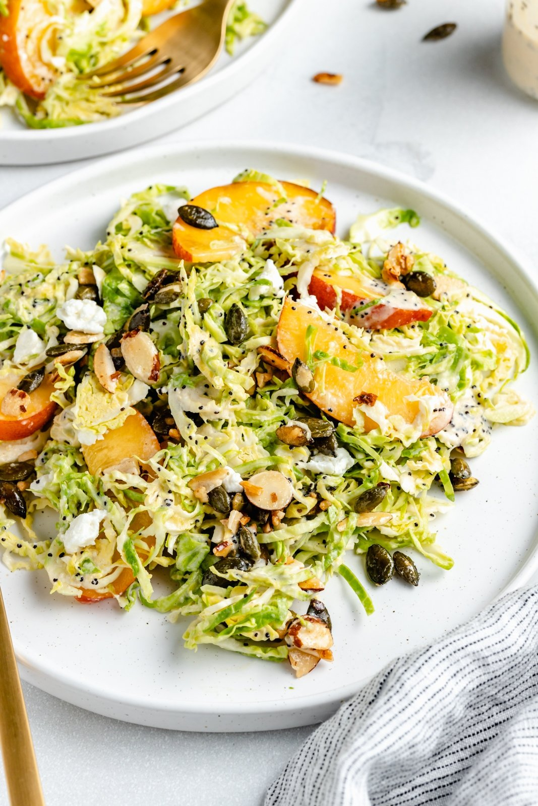 brussels sprouts peach salad on a plate