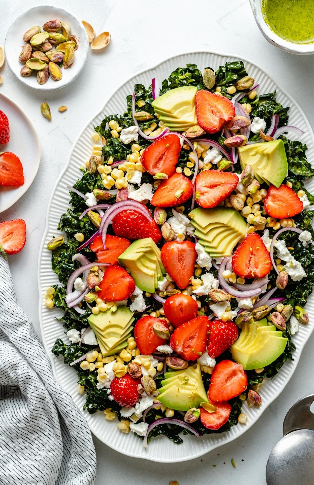 summer kale salad with strawberries on a platter