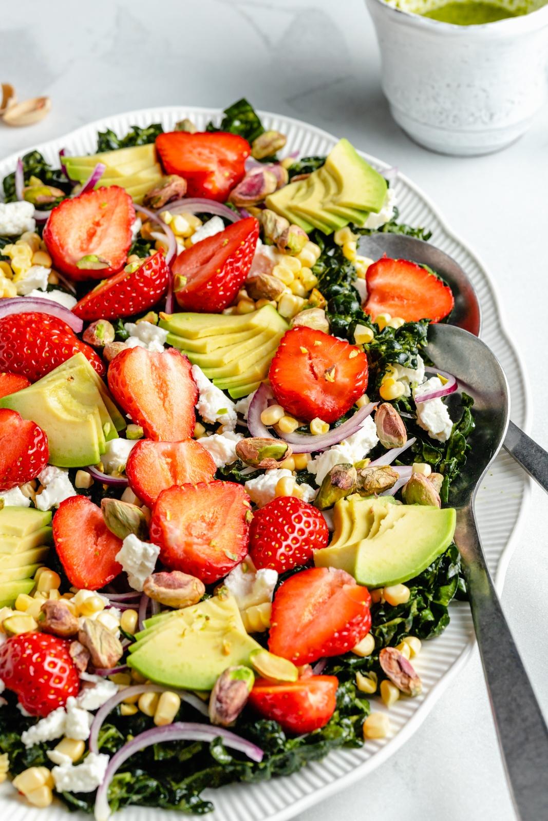 strawberry kale salad on a platter