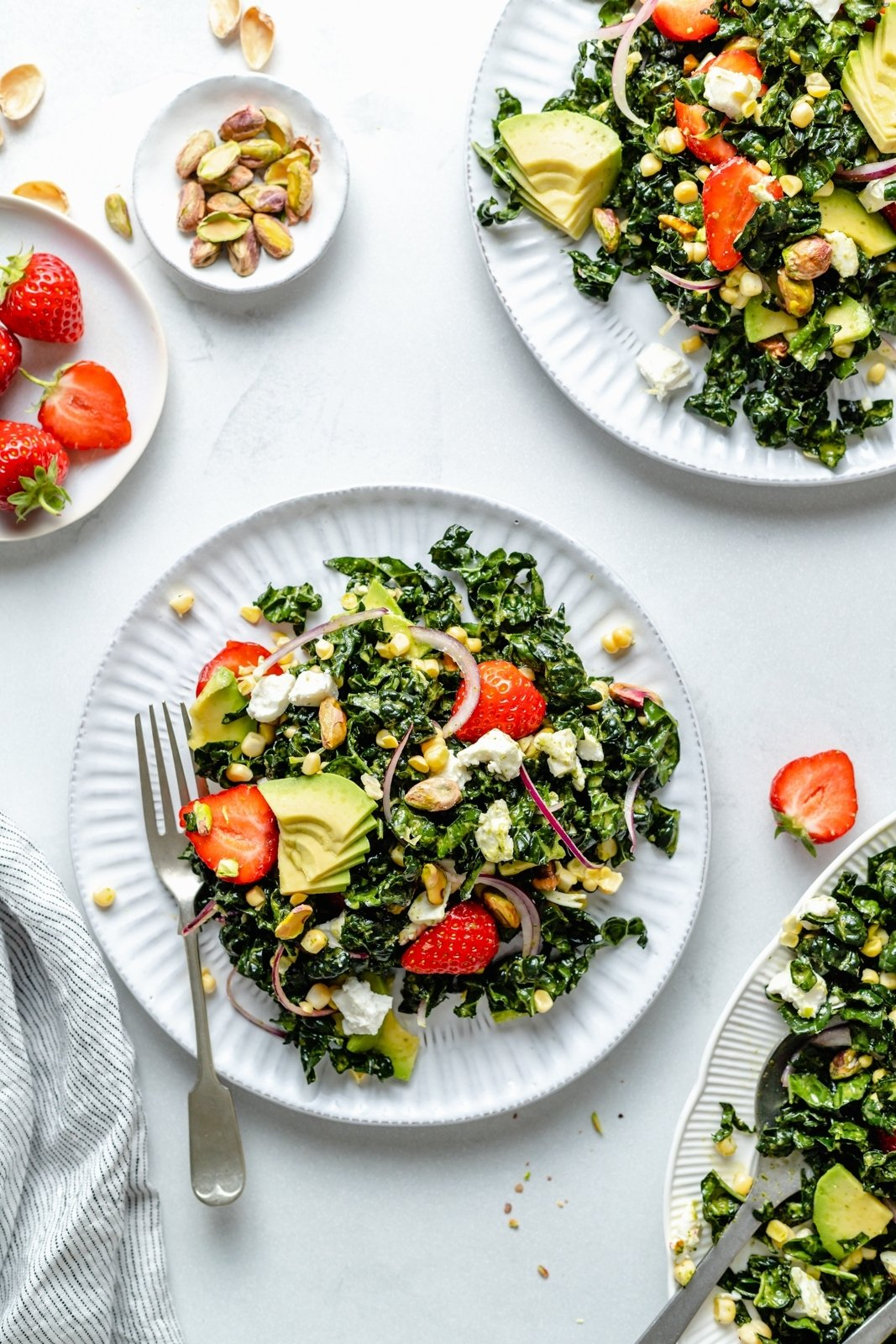 summer kale salad on two plates