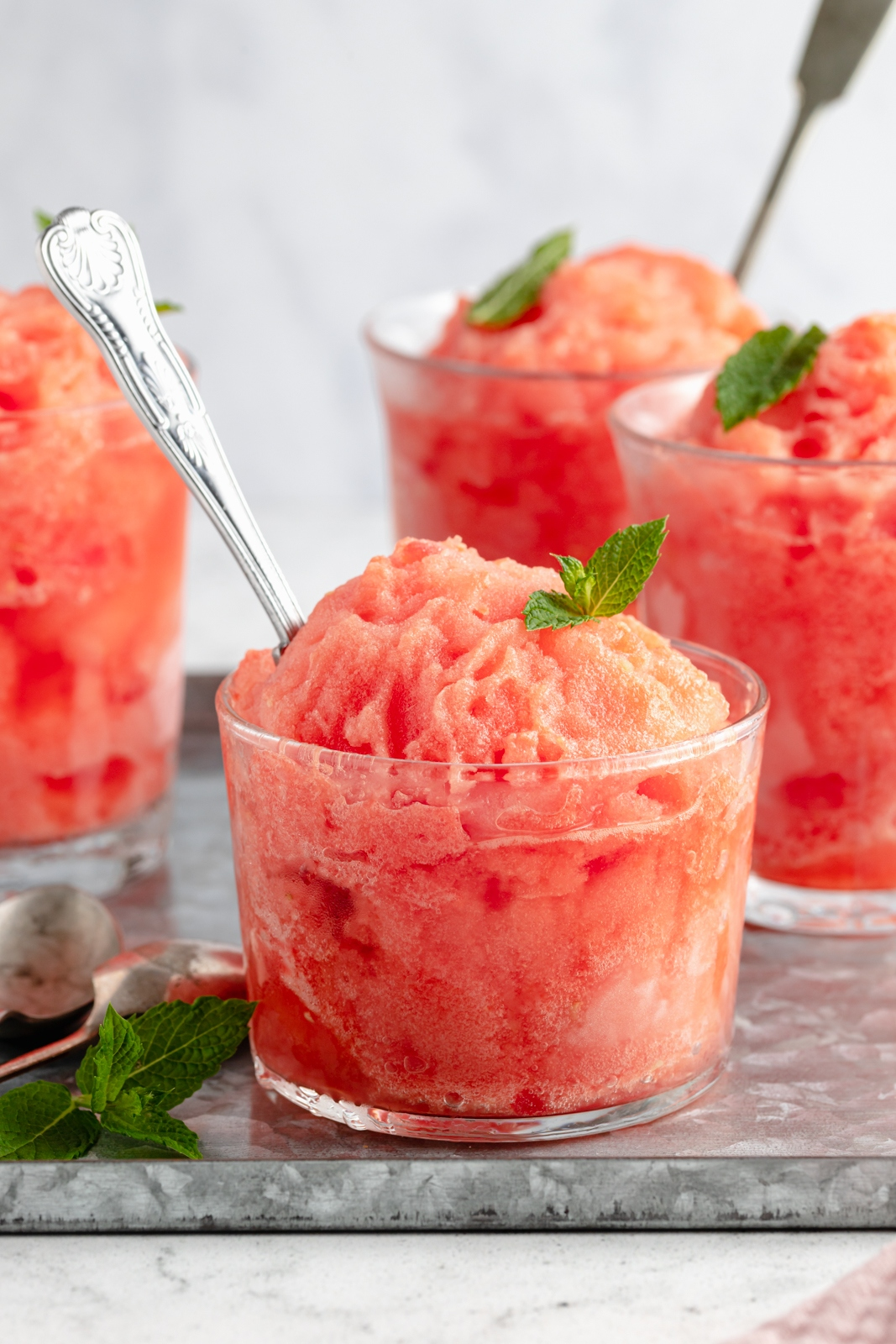 watermelon frosé in a glass with a spoon