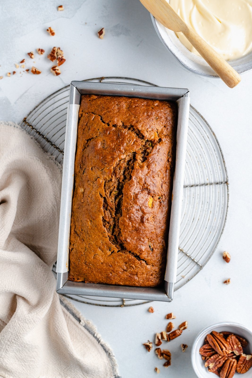 apple zucchini bread with applesauce in a loaf pan