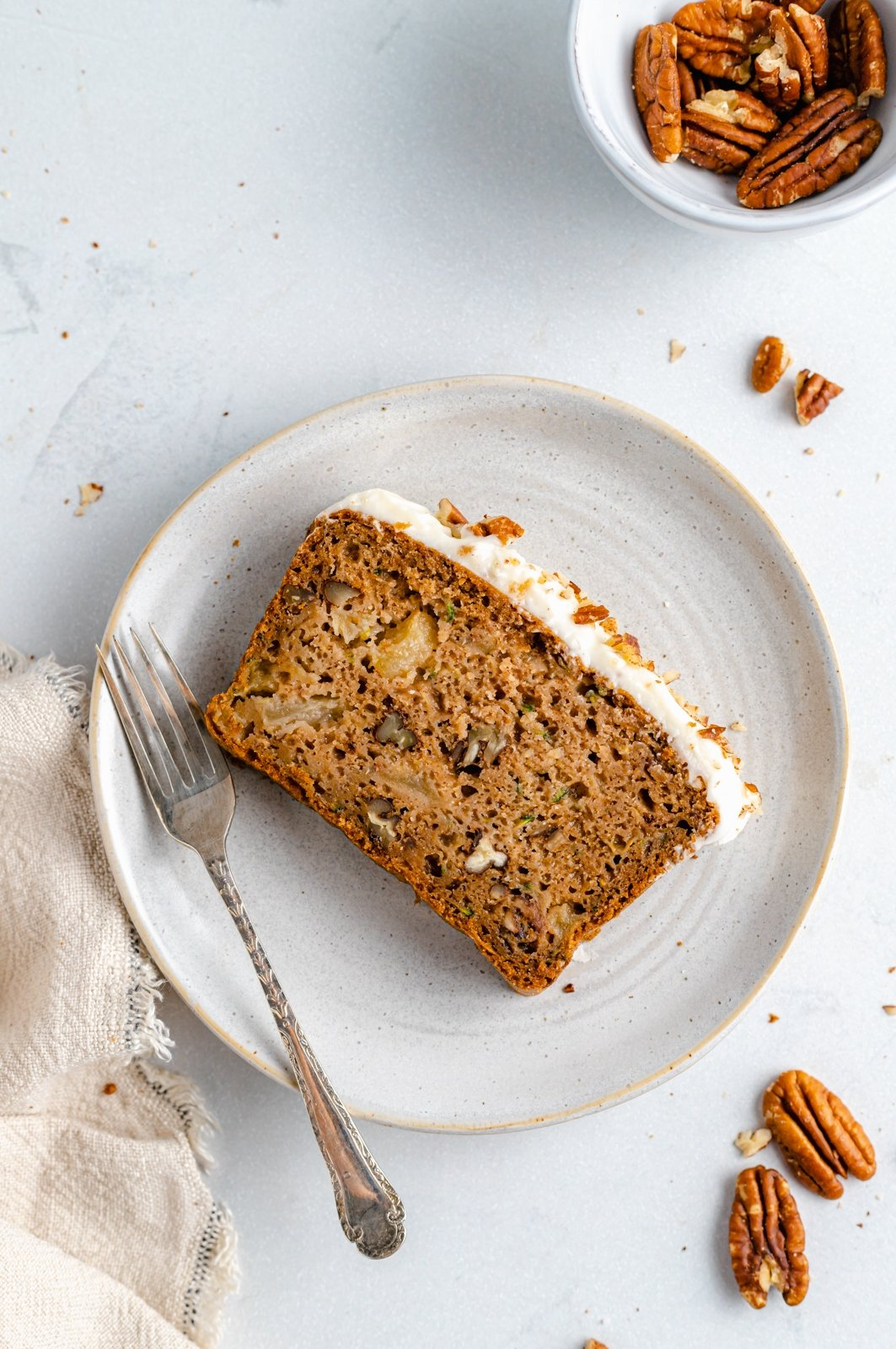slice of zucchini apple bread on a plate