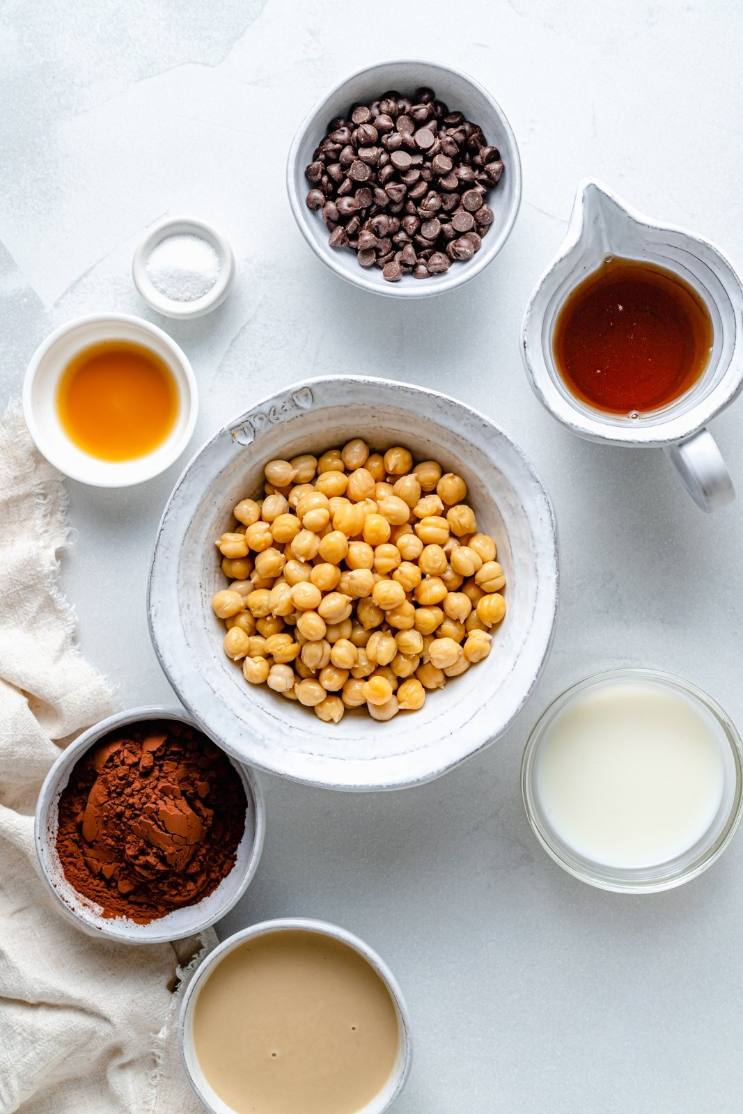 ingredients for healthy chocolate hummus in bowls