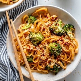 vegan tahini noodles with broccoli in a bowl