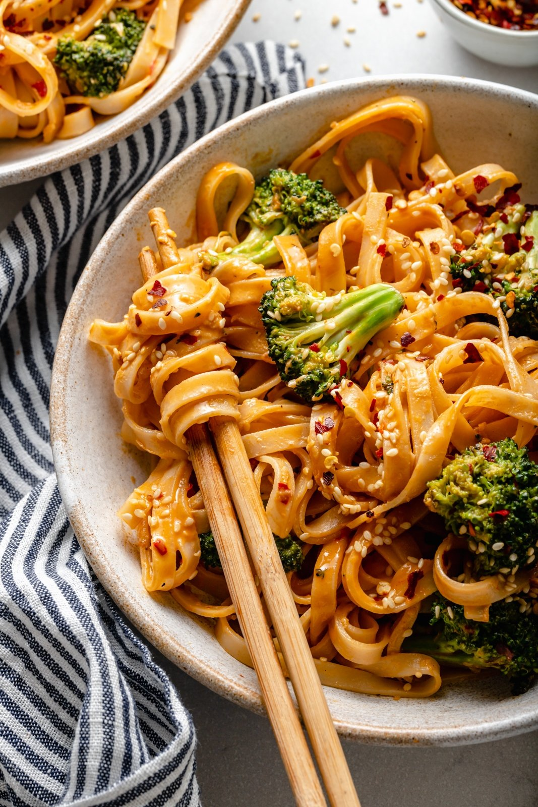 sweet and spicy tahini noodles with broccoli in a bowl