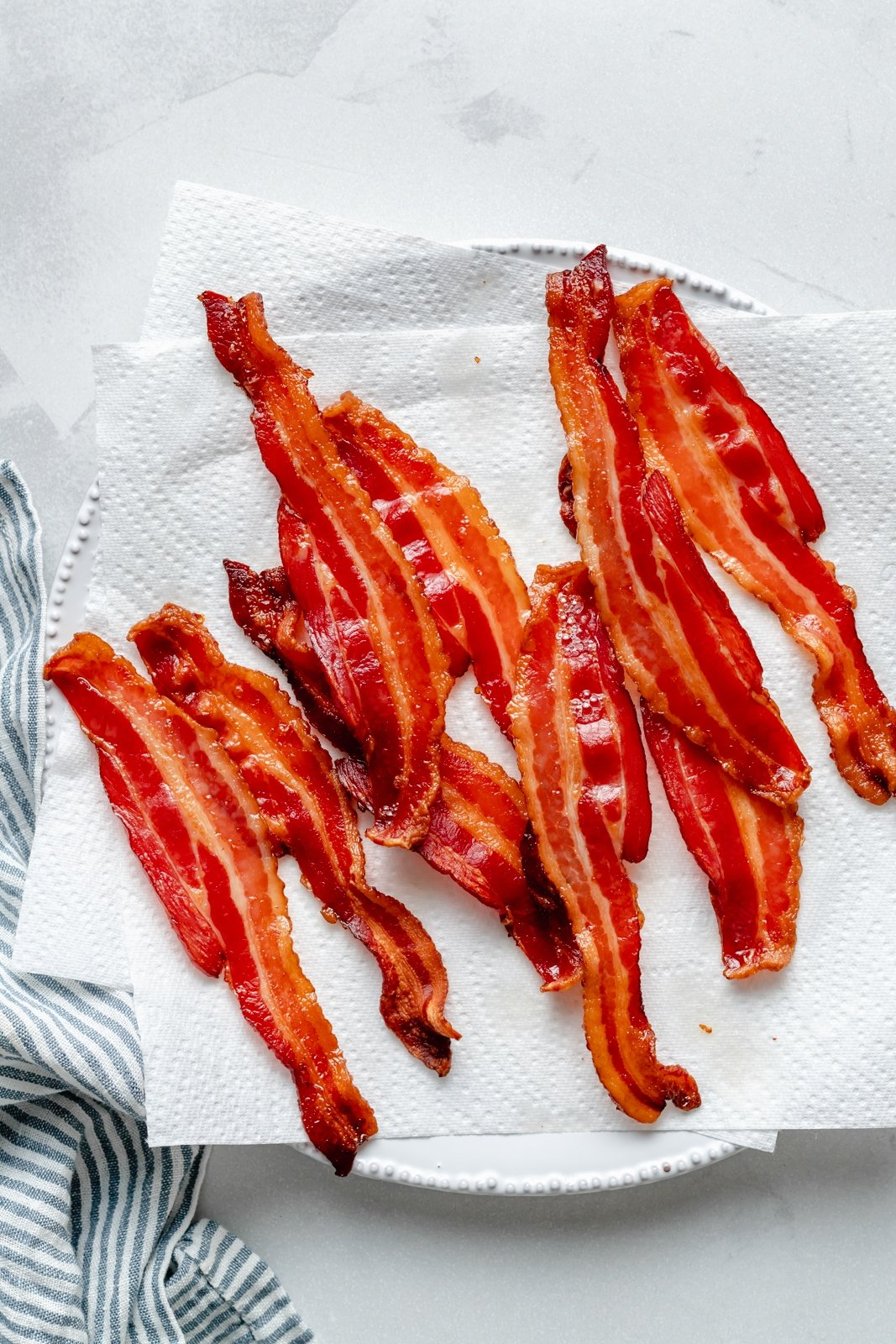 crispy bacon on a plate with paper towels