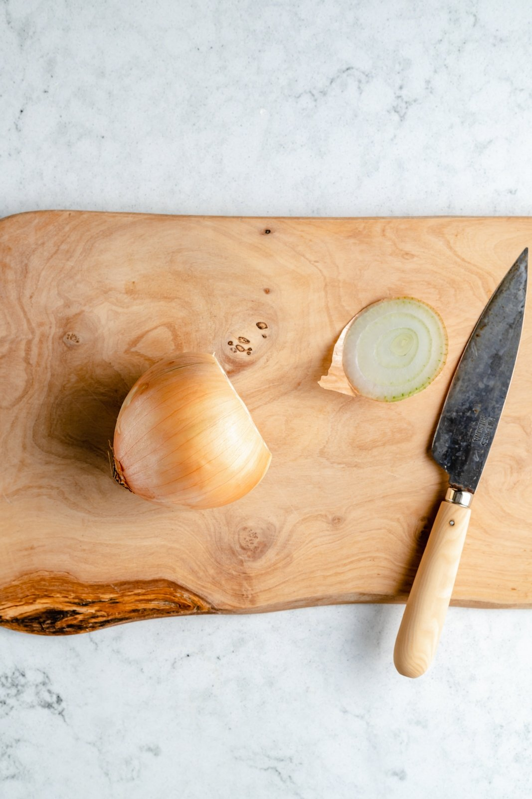 onion on a cutting board with the stem cut off