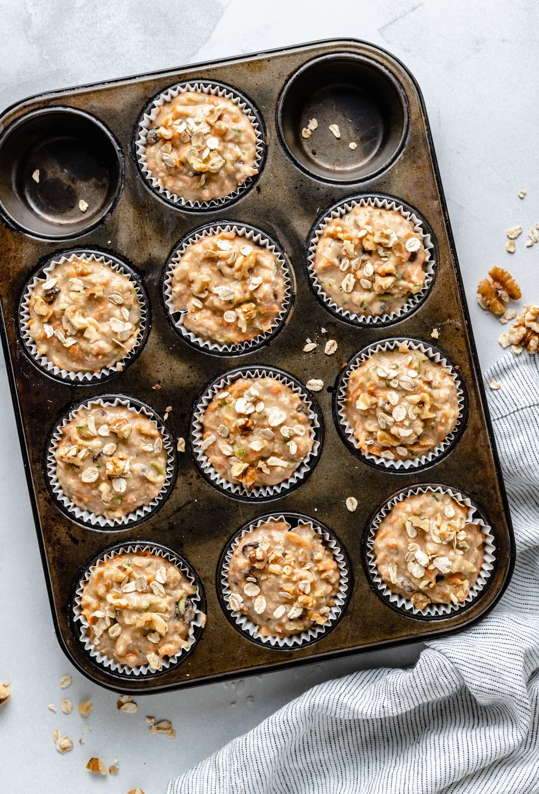 unbaked zucchini carrot muffins in a muffin tin
