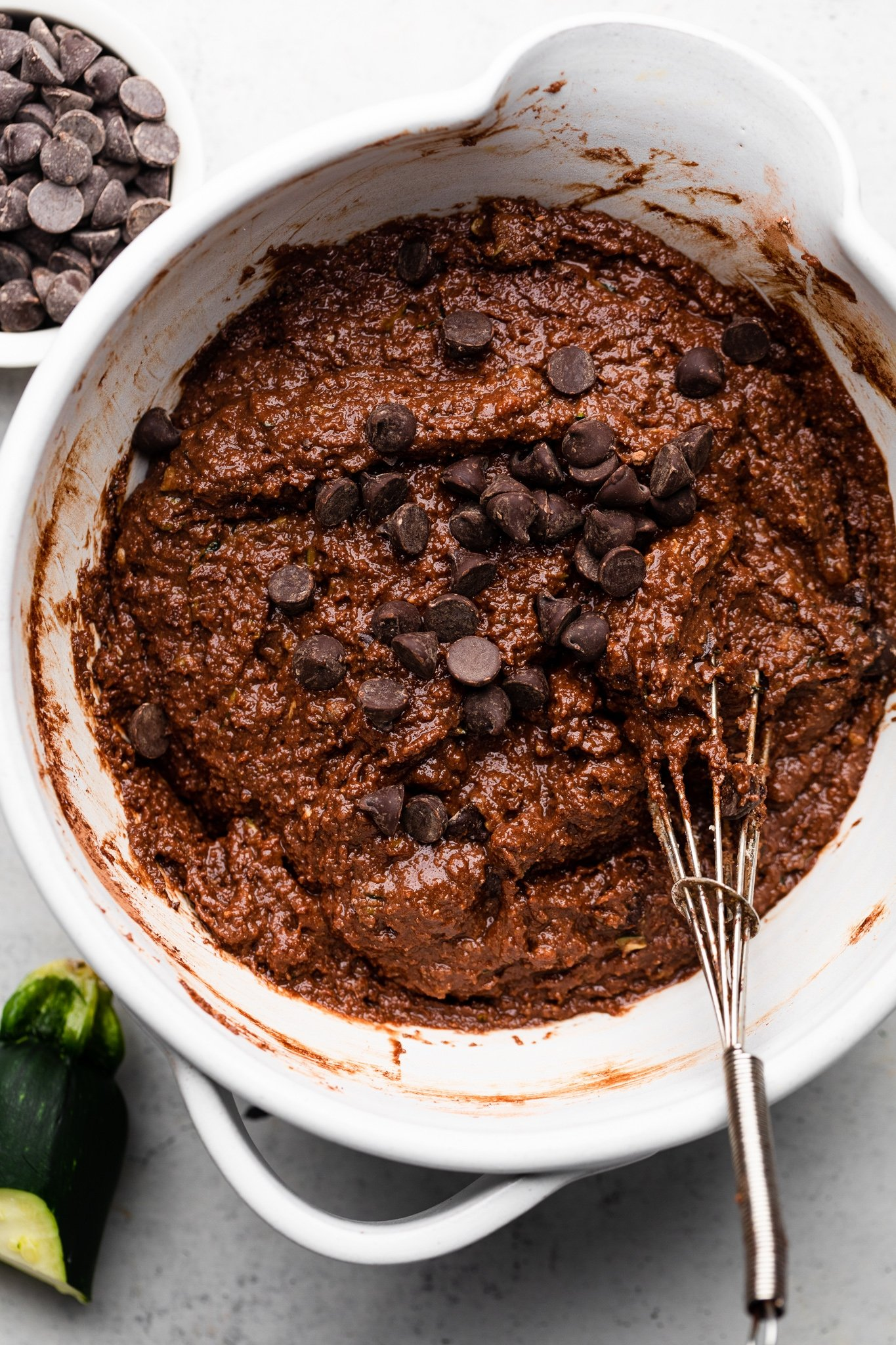 mixing batter for healthy chocolate zucchini cake