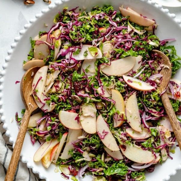 kale apple salad in a serving bowl