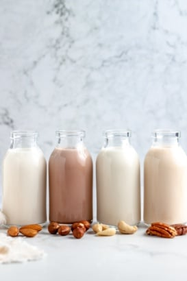 homemade nut milk in four different jars