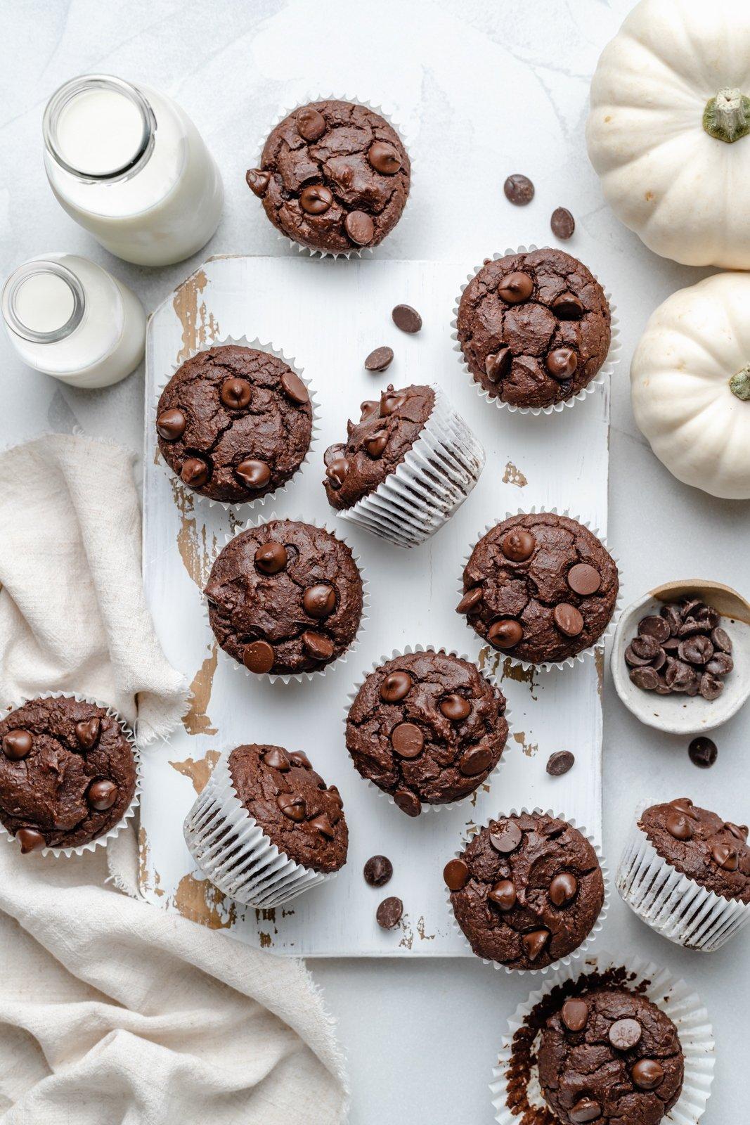 gluten free chocolate almond butter pumpkin muffins on a board