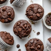 healthy almond butter chocolate pumpkin muffins on a marble board