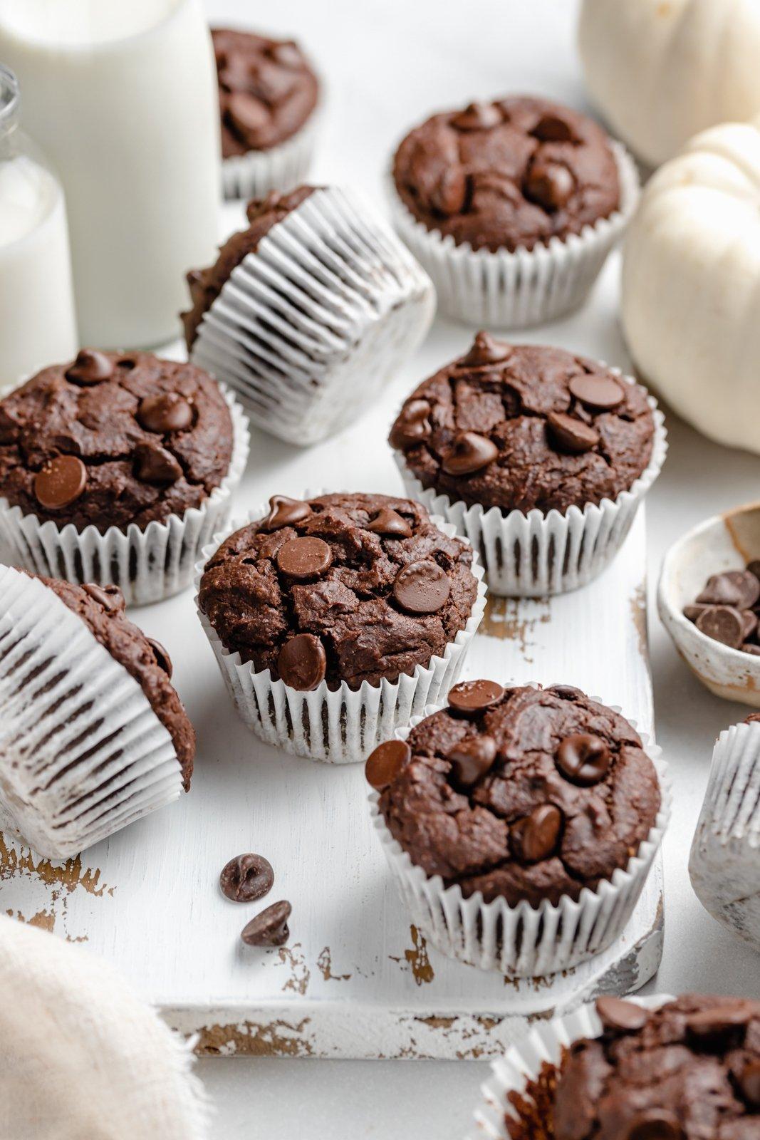 healthy chocolate pumpkin muffins on a board
