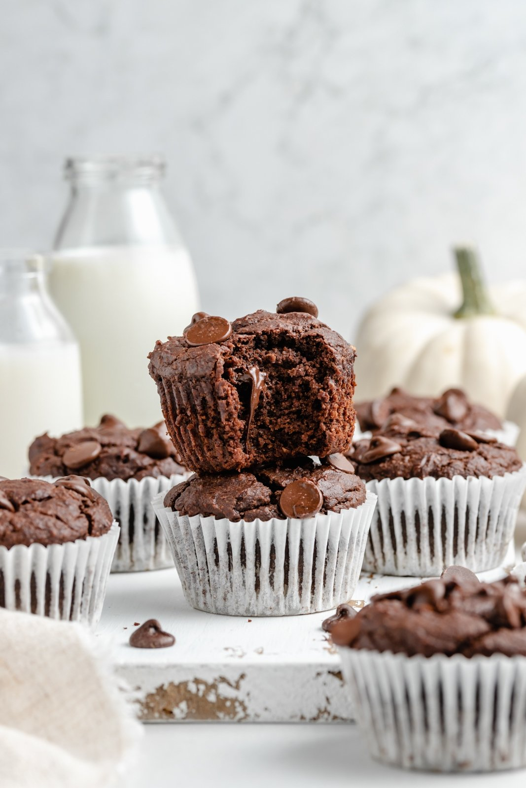 two almond butter chocolate pumpkin muffins stacked