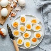 perfect hard boiled eggs sliced on a plate