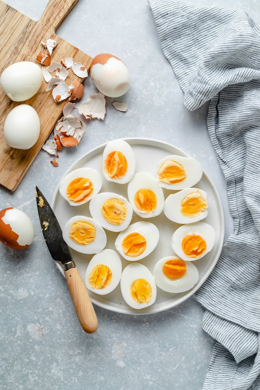 the best hard boiled eggs cut in half on a plate