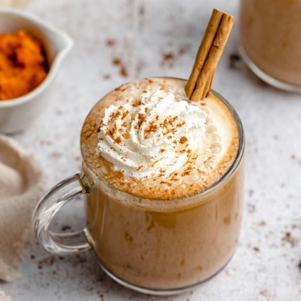 homemade pumpkin spice latte in a mug topped with whipped cream