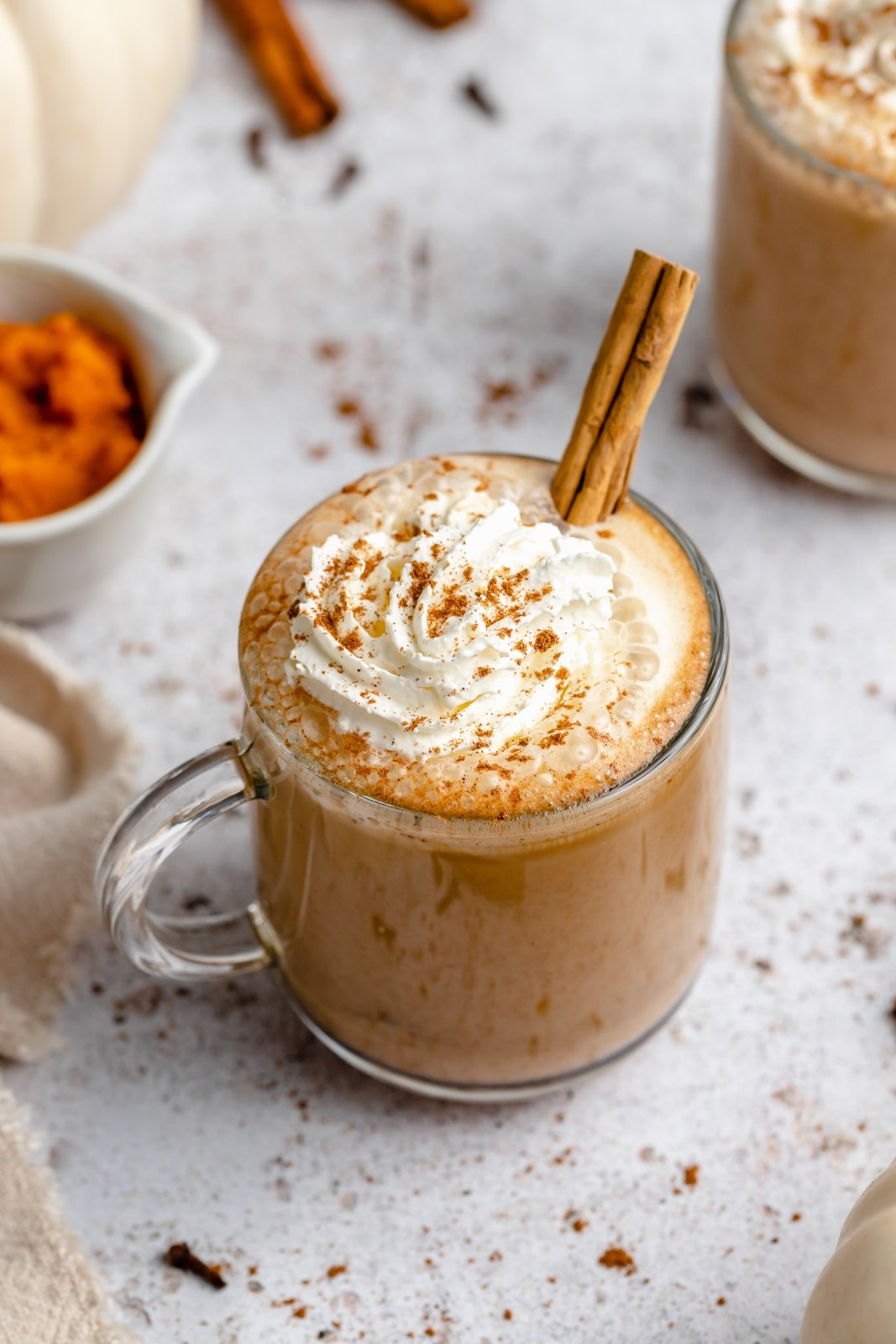 homemade pumpkin spice latte with whipped cream in a mug