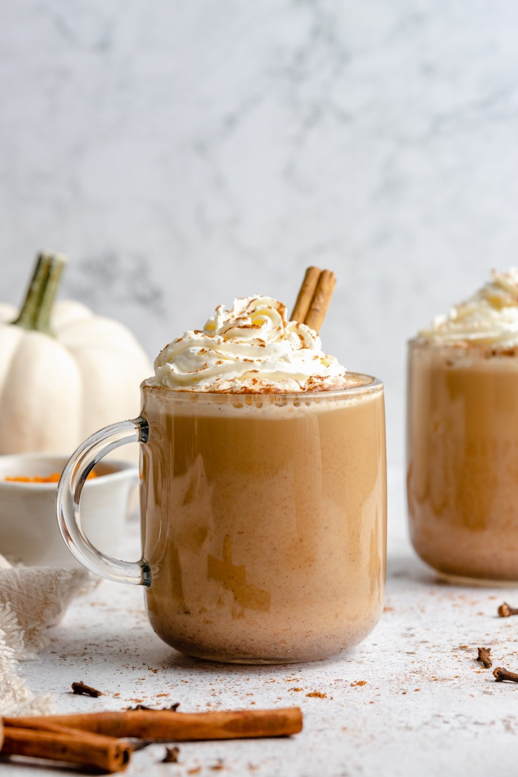 easy pumpkin spice latte in a mug topped with whipped cream