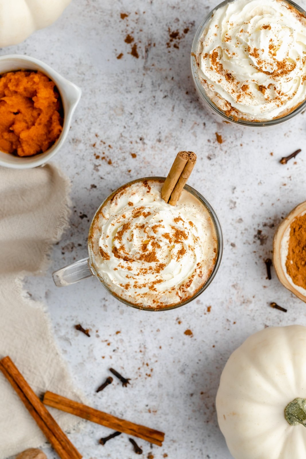 top down view of two homemade pumpkin spice lattes