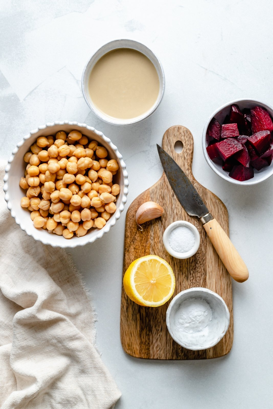 ingredients for beet hummus on a grey board