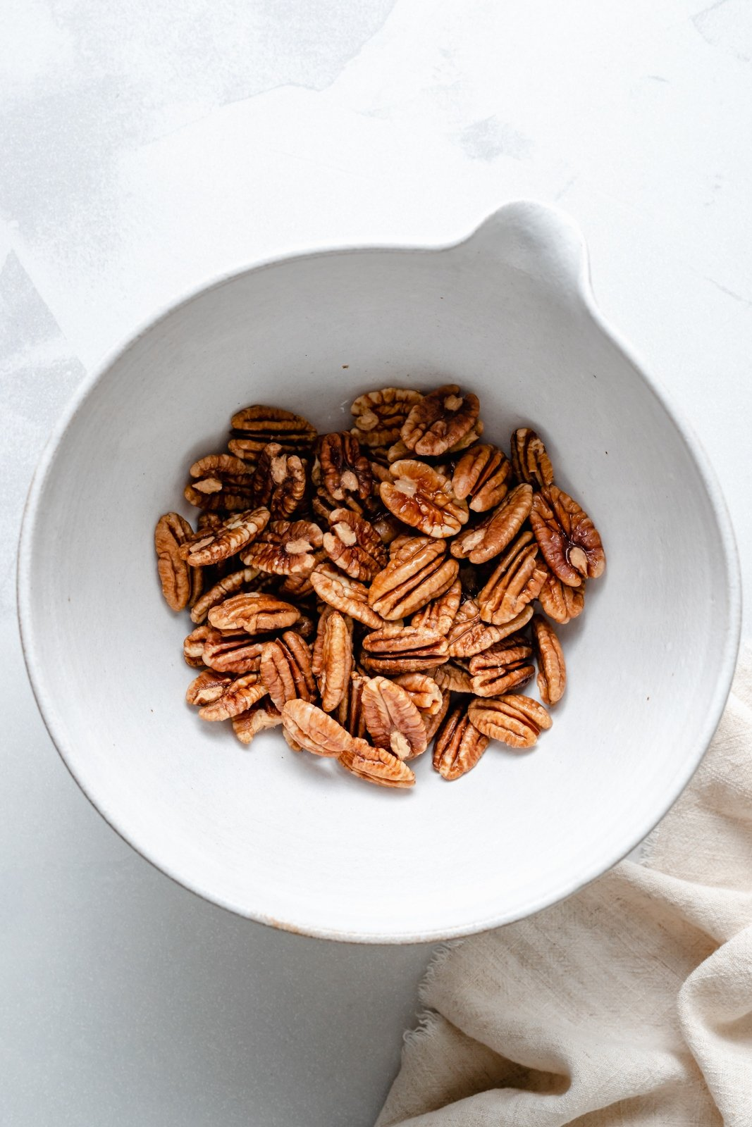 soaked pecans in a bowl to make homemade pecan milk