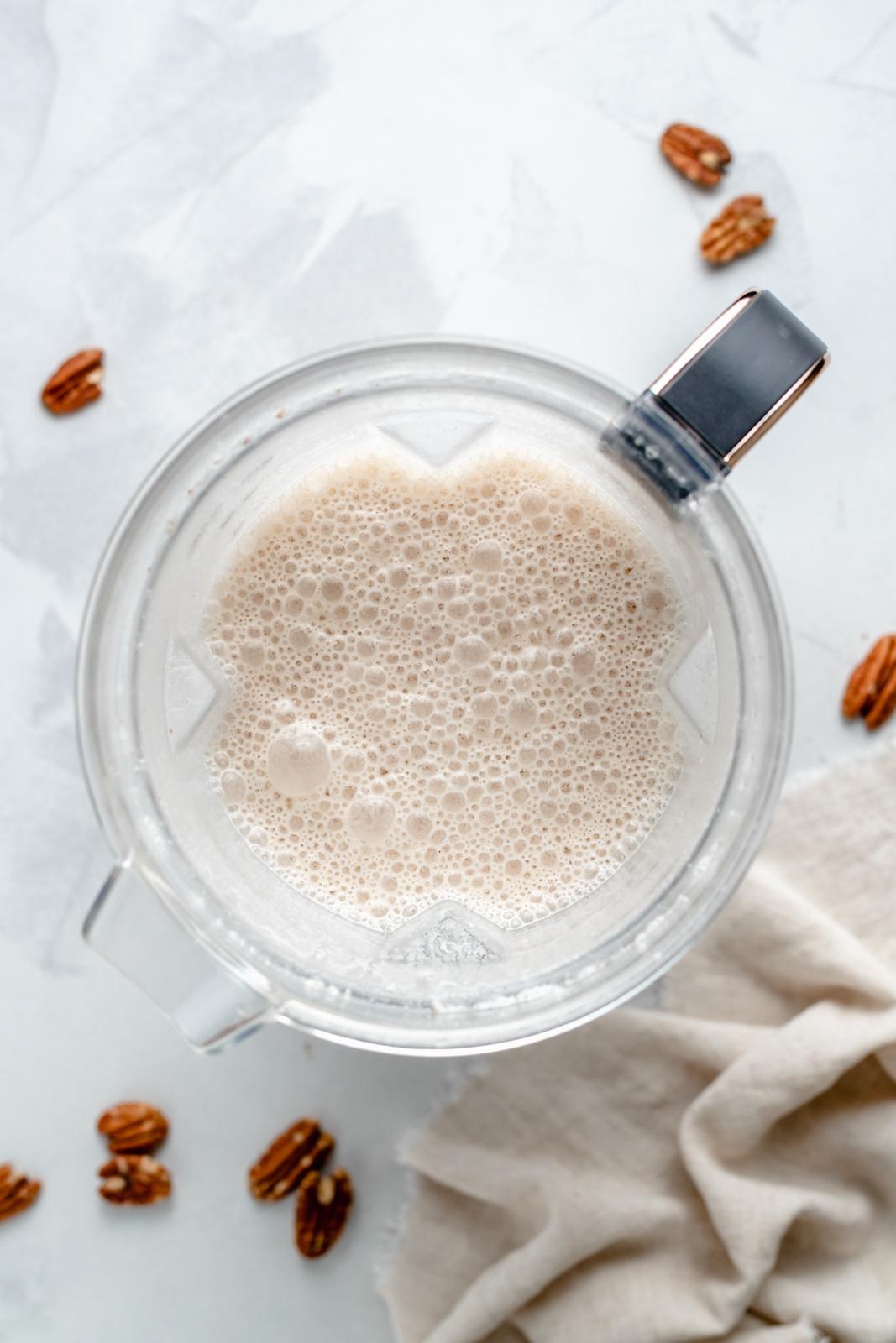 top-down view of homemade pecan milk in a blender